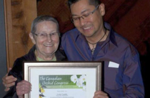 Lynne Cassidy of the Fraser Valley Orchid Society receives COC award
